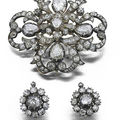 A mid 19th century diamond brooch and earrings