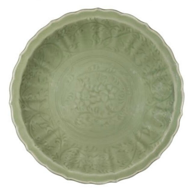 A Longquan celadon-glazed 'lotus scroll' barbed-rim dish, 14th-15th century