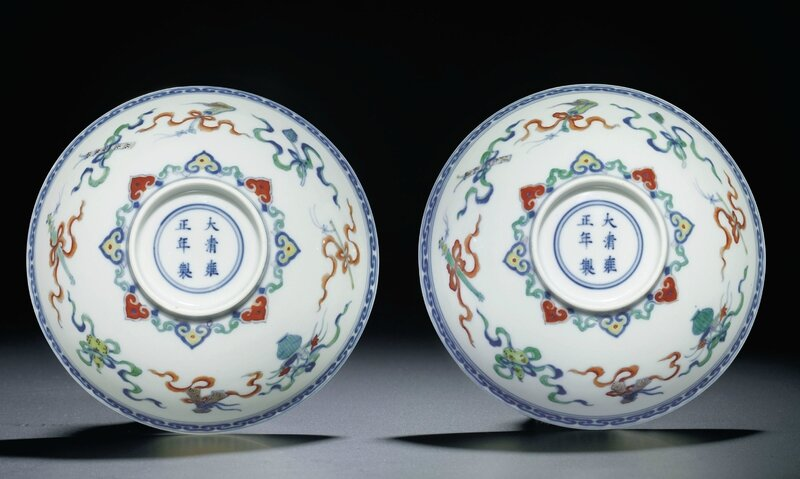 A fine pair ofdoucai'Daoist emblems' bowls, Yongzheng six-character marks within double circles and of the period (1723-1735)