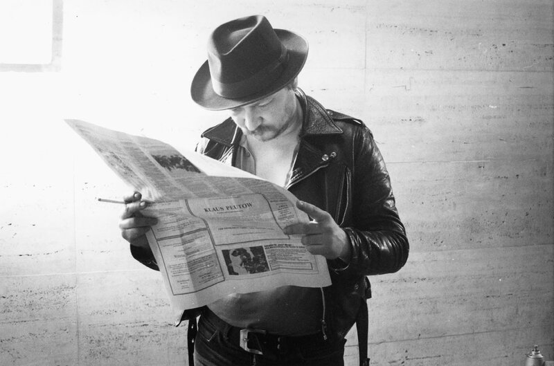 Fassbinder reading newspaper