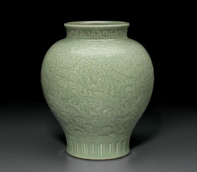 A rare relief-decorated celadon-glazed baluster vase, Qianlong six-character seal mark and of the period (1736-1795)