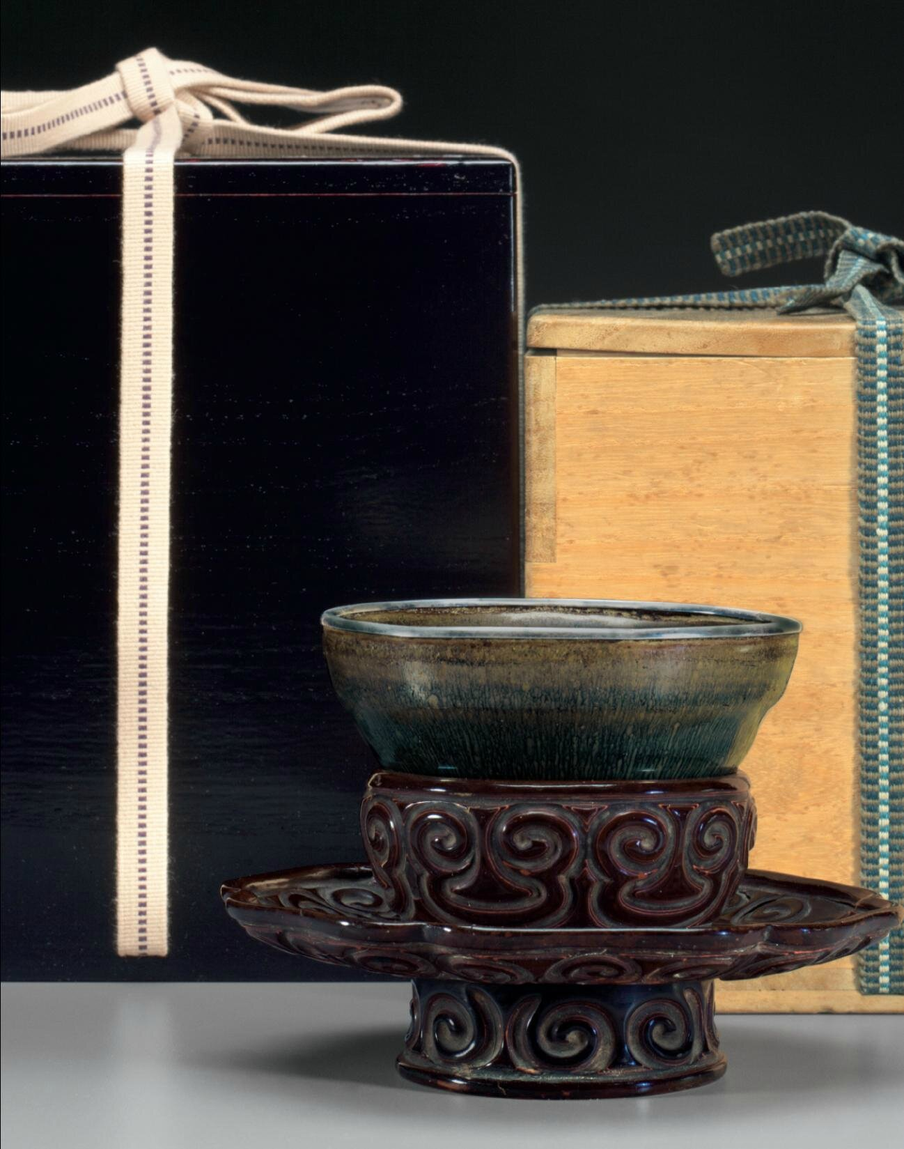 An exceptional Jianyao 'Hare's fur' tea bowl and a tixi lacquer stand bowl, Southern Song dynasty