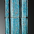 Two monumental turquoise-glazed calligraphic tiles, signed by yusuf ibn 'ali [ibn] muhammad ibn abi [tahir], probably kashan