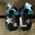 Cadeau de naissance: des petits chaussons en cuir...