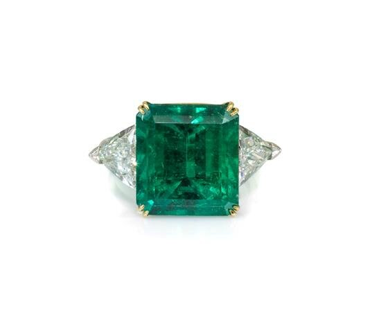 A Platinum, 18 Karat Yellow Gold, Emerald and Diamond Ring, Harry Winston