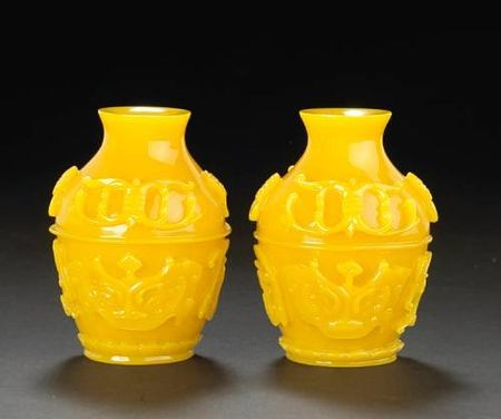A_pair_of_yellow_glass_miniature_vases