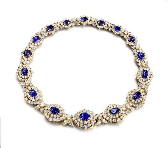 A sapphire and diamond necklace, ring and earring suite