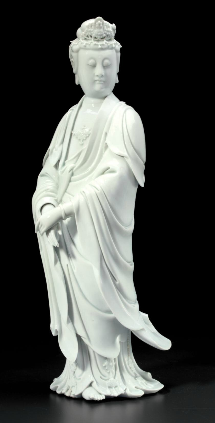 A large Dehua figure of Guanyin, 19th century