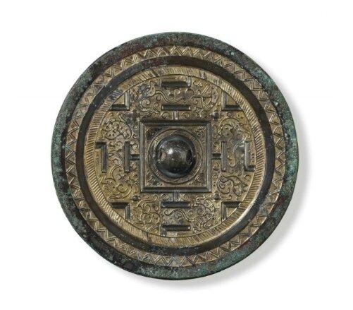 A parcel-gilt bronze circular 'TLV' mirror, China, Western Han dynasty, 2nd-1st Century BC