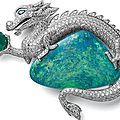Cartier platinum brooch with one opal, one ribbed emerald, diamonds and eyes of emerald