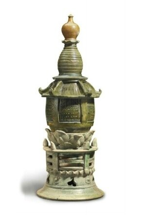 A large green and amber-glazed pottery three-part model of a stupa, China, Liao dynasty (AD 907-1125)