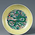 A doucai dragon dish, china. six-character mark kangxi and of the period