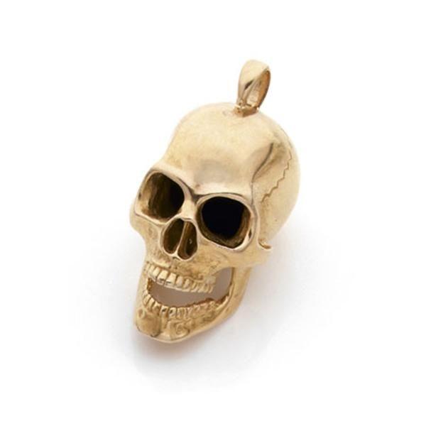 CORPUS CHRISTI. Pendentif tête de mort en or jaune