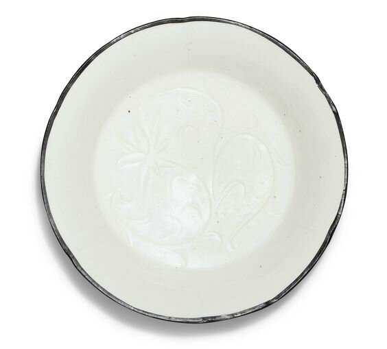 A carved 'Ding' lobed dish, Northern Song dynasty (960-1127)