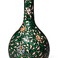 A black-ground famille verte 'floral' bottle vase, qing dynasty, yongzheng period (1723-1735)