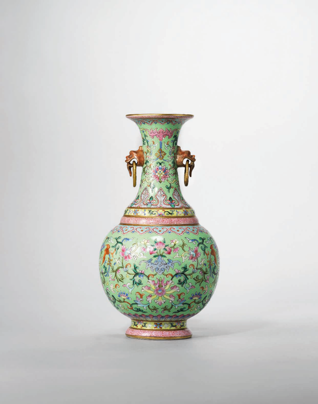 A lime-green ground famille rose twin-handled vase, Jiaqing six-character sealmark in iron-red and of the period (1796-1820)