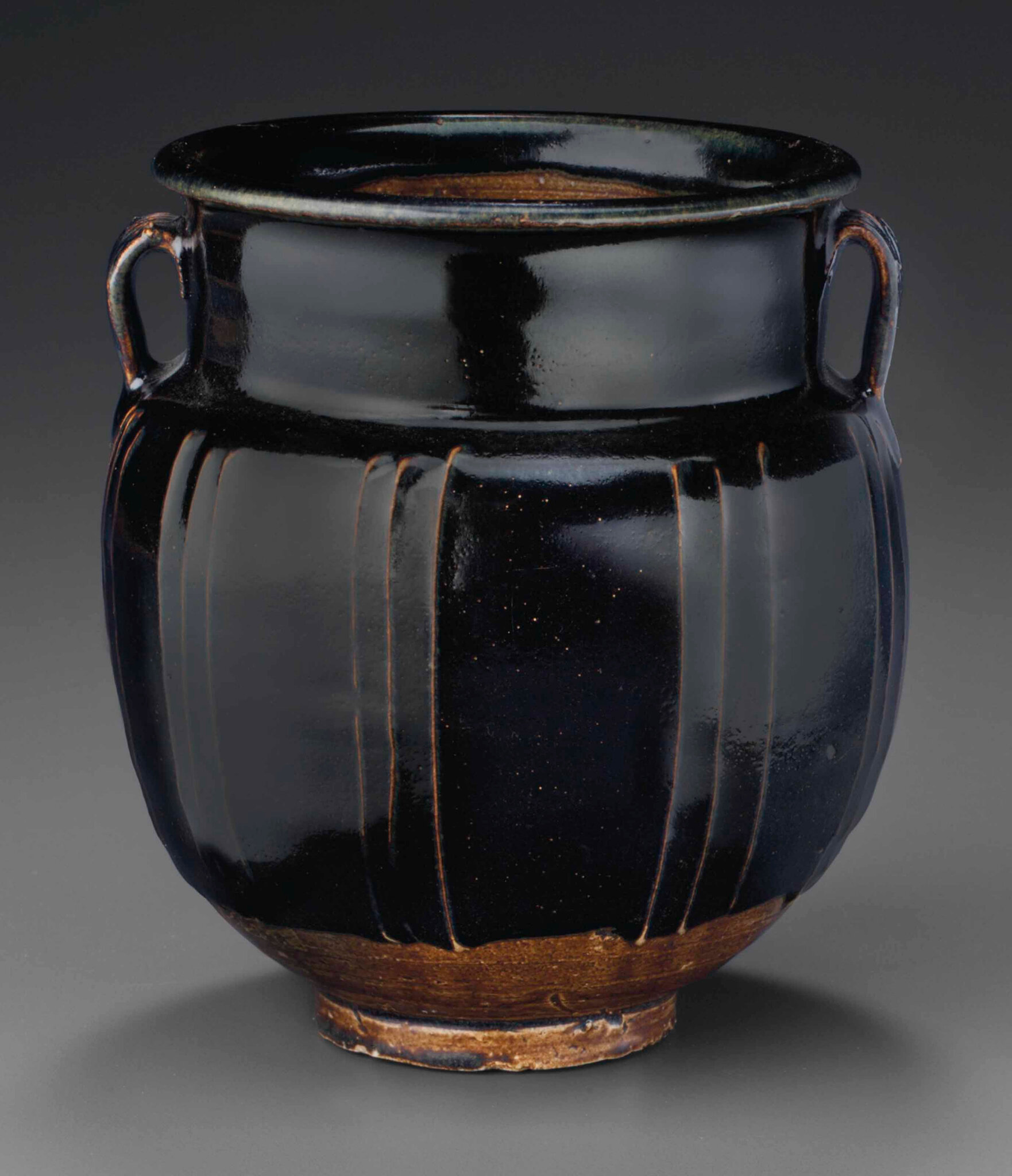 A Cizhou-type black-glazed ribbed jar, Northern Song-Jin dynasty, 12th century