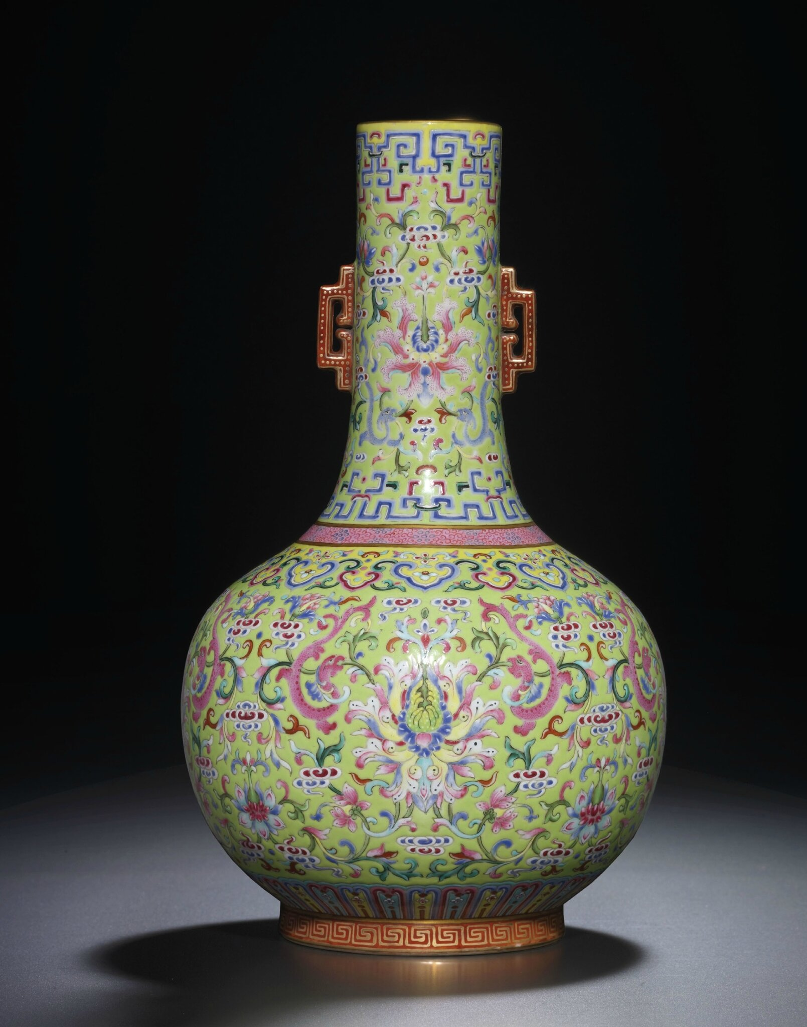 A fine lime-green ground famille-rose bottle vase, Jiaqing iron red six-character seal mark and of the period (1796-1820)