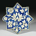 An ilkhanide pottery star tile, persia, early 14th century. photo sotheby's. moulded in relief and decorated in underglaze coba