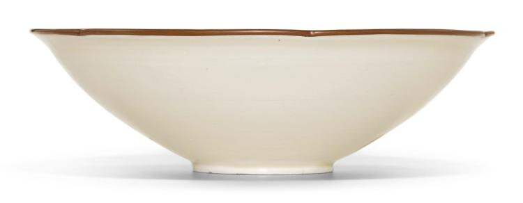 A fine and rare carved 'Ding' 'Lotus' bowl, Northern Song dynasty (960-1127)