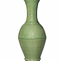 A large carved Longquan celadon 'phoenix-tail' vase, Ming dynasty, early 15th century