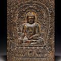 A very rare gilded and painted limestone buddhist plaque, late yuan-early ming dynasty, late 14th century