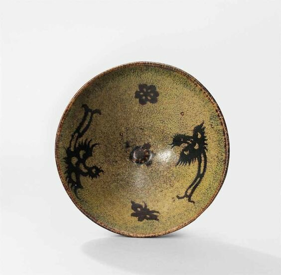 A Jizhou 'phoenix and prunus' paper-cut resist-decorated tea bowl, Southern Song Dynasty (1127-1279)