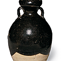An unusual small dark brown-glazed double-gourd vase, late Tang dynasty, 9th century