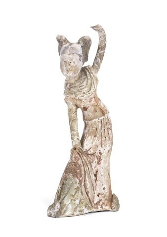A painted pottery figure of a female dancer, Tang Dynasty