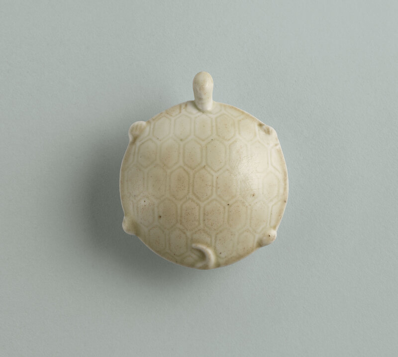 A fine rare Ding turtle-form tea grinder, Early Northern Song dynasty, 10th-11th century