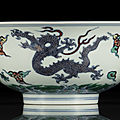 A fine and rare doucai dragon bowl, kangxi six-character mark and of the period (1662-1722)
