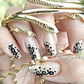 Nail art arabesques noir et or
