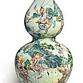 A rare famille-rose 'tribute bearers' double gourd vase, qianlong seal mark and period (1736-1795)
