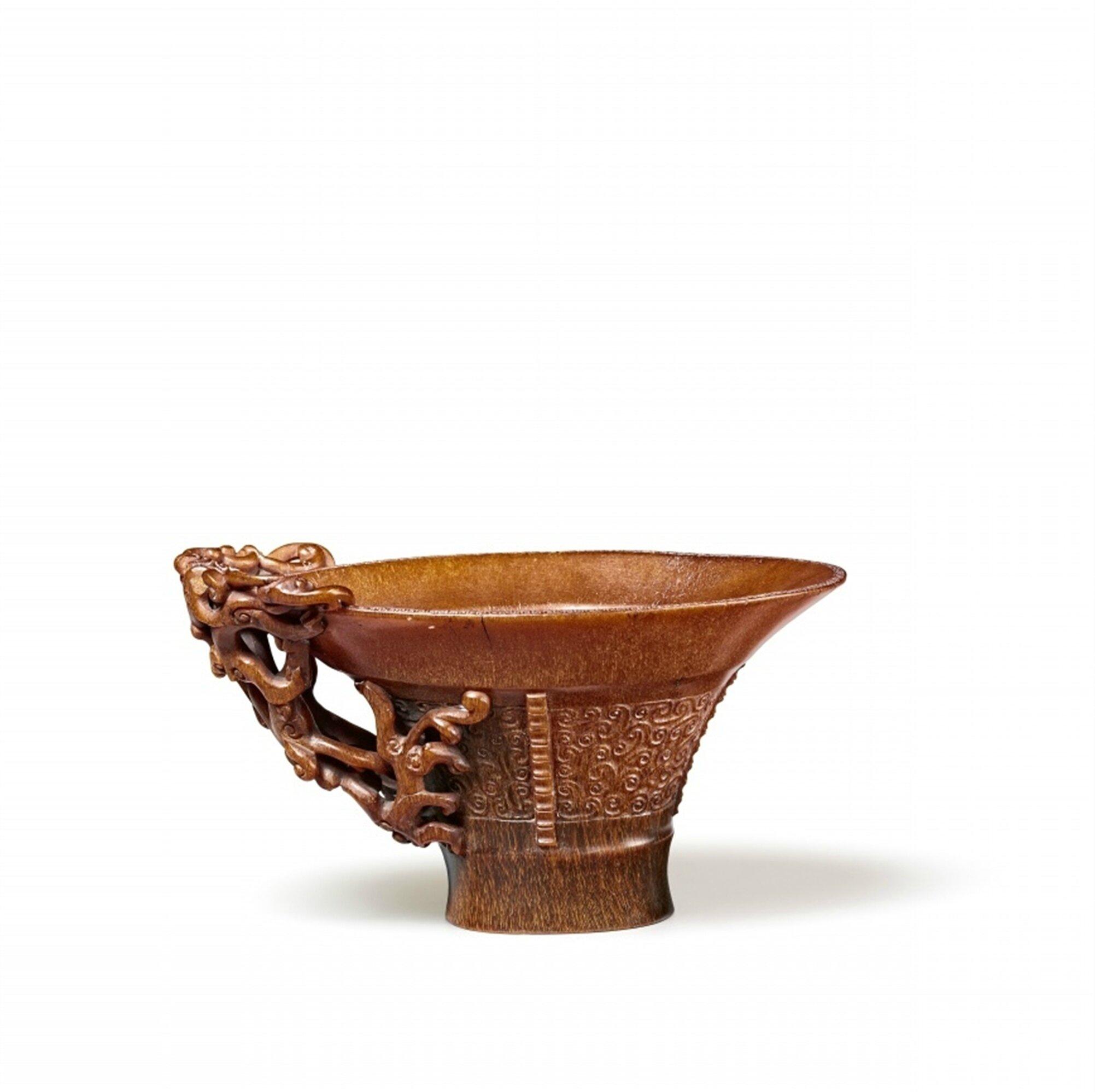 A fine archaistic rhinoceros libation cup, Qing dynasty