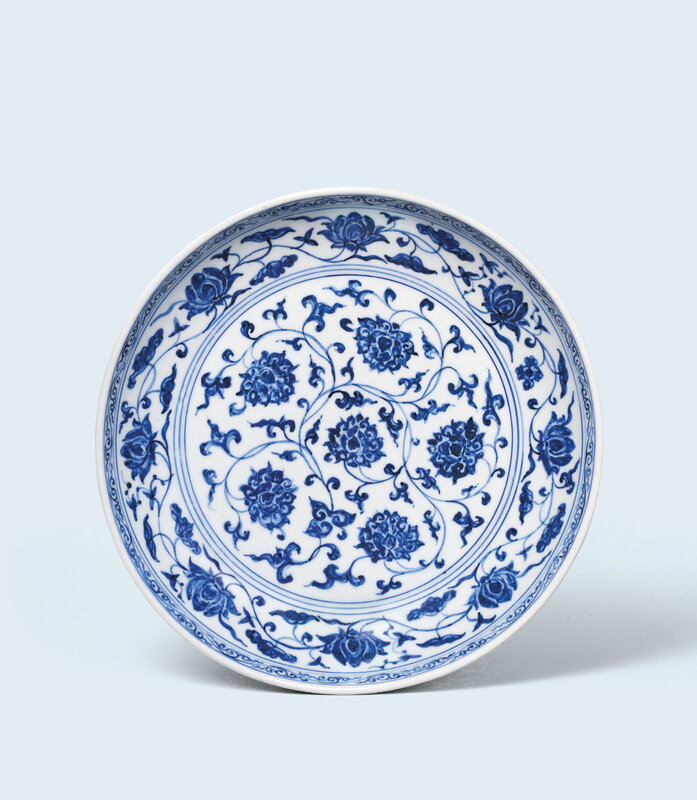 A fine and extremely rare early-Ming blue and white 'lotus' dish, Xuande six-character mark in underglaze blue in a line and of the period (1426-1435)