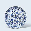 A fine and extremely rare early-ming blue and white 'lotus' dish, xuande six-character mark and of the period (1426-1435)