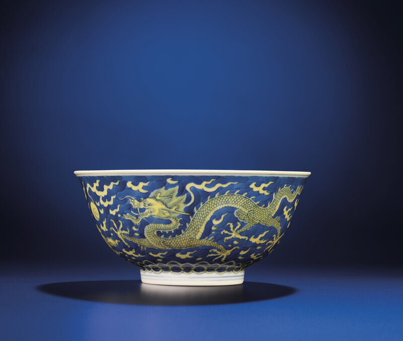A fine yellow-enamelled blue and white 'Dragon' bowl, Qianlong six-character seal mark and of the period (1736-1795)