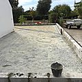 Réalisation d'un garage en parpaings sur 3m de hauteur.