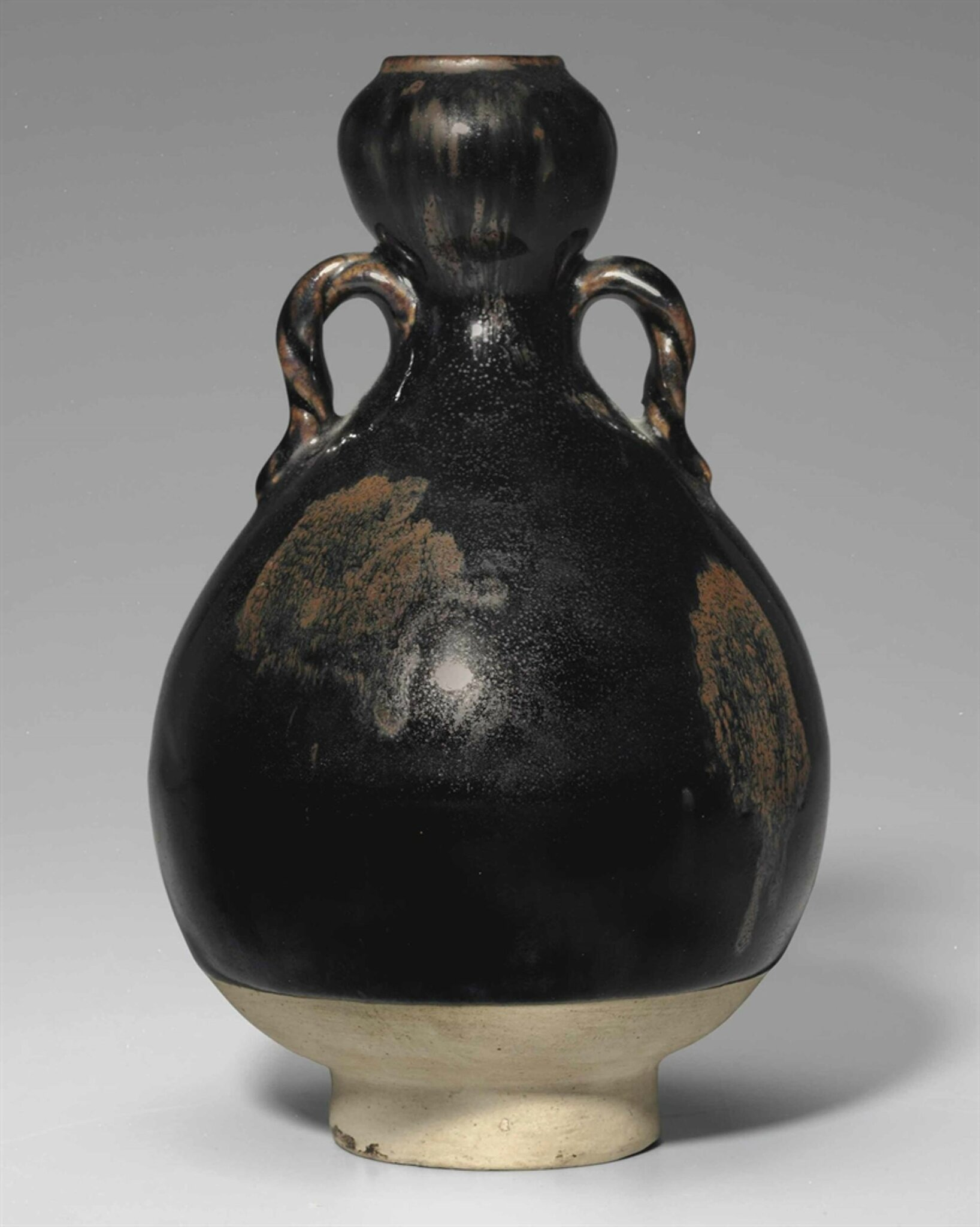 An unusual small russet-splashed black-glazed garlic-mouthed bottle, Northern Song dynasty, 11th-12th century