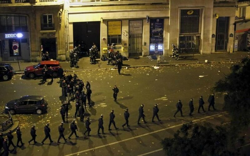 826351-french-police-with-protective-shields-walk-in-line-near-the-bataclan-concert-hall-following-fatal-sh