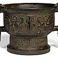 An archaic bronze ritual food vessel and cover, gui, western zhou dynasty (1050-771 bc)
