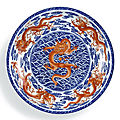 A magnificent and rare underglaze-blue and iron-red decorated 'nine dragon' charger, seal mark and period of qianlong