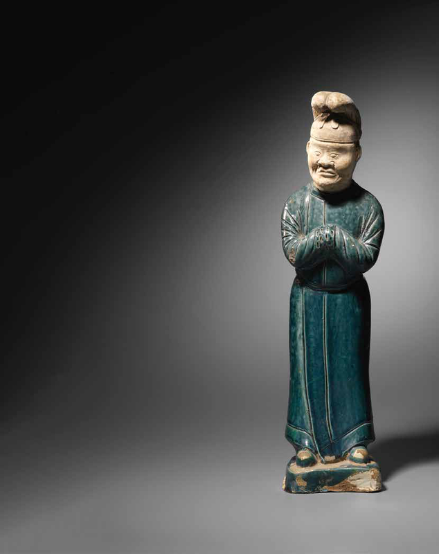 A rare blue-glazed pottery figure of a male attendant, Tang Dynasty (618-907)