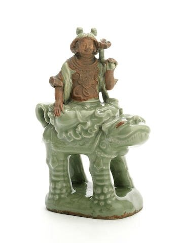 A Longquan celadon-glazed figure of the Bodhisattva Wenshu riding a Buddhist lion, Ming Dynasty