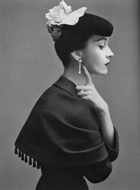 Dovima wearing Balenciaga's suit with capelet of black silk satin matelassé, photo by Richard Avedon for Harper's Bazaar, October 1950