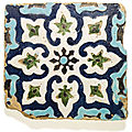 A large timurid moulded cuerda-seca pottery tile, central asia, late 14th century