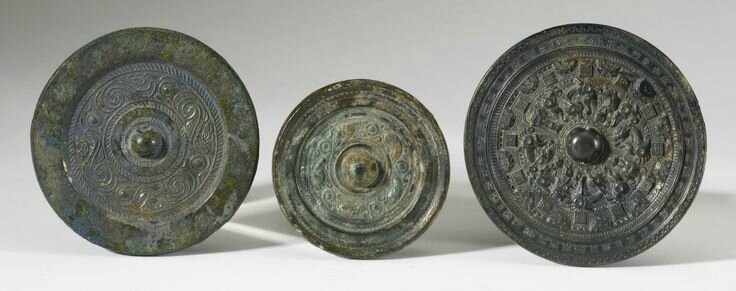 A bronze mirror with deities and inscriptions, Eastern Han Dynasty