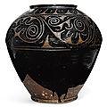 A carved 'Cizhou' 'floral' jar, Yuan-Ming dynasty (1279-1644)