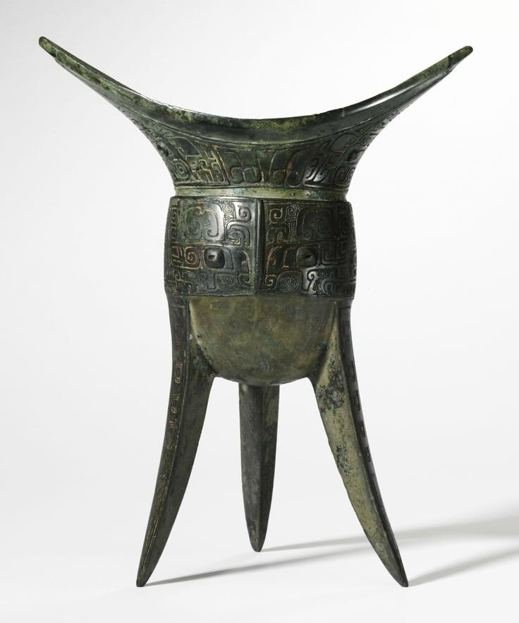 The Tian Mian Fu Yi Jiao, An Important and Very Rare Bronze Ritual Wine Vessel. Late Shang Dynasty, 13th-11th Century BC. Height 9 3/8 in., 23.8 cm