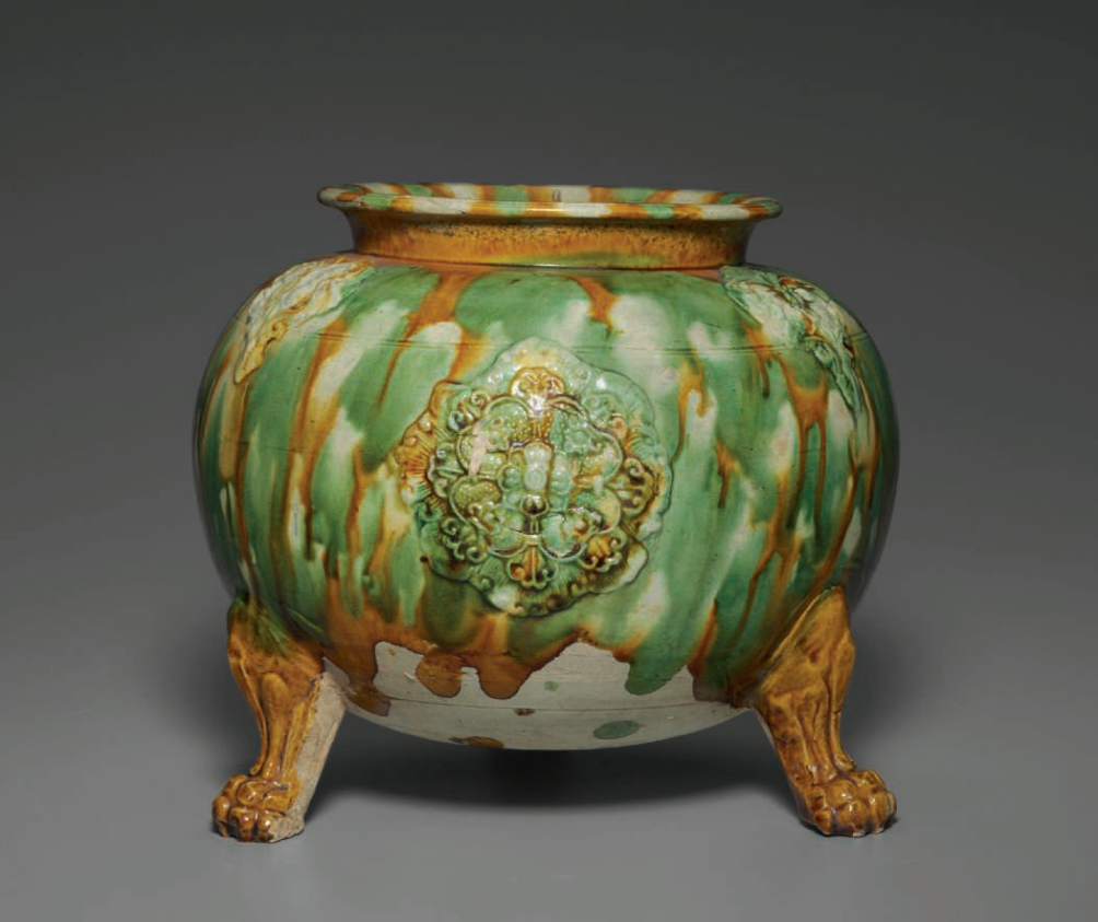 A sancai-glazed applique-decorated tripod jar, Tang dynasty (AD 618-907)